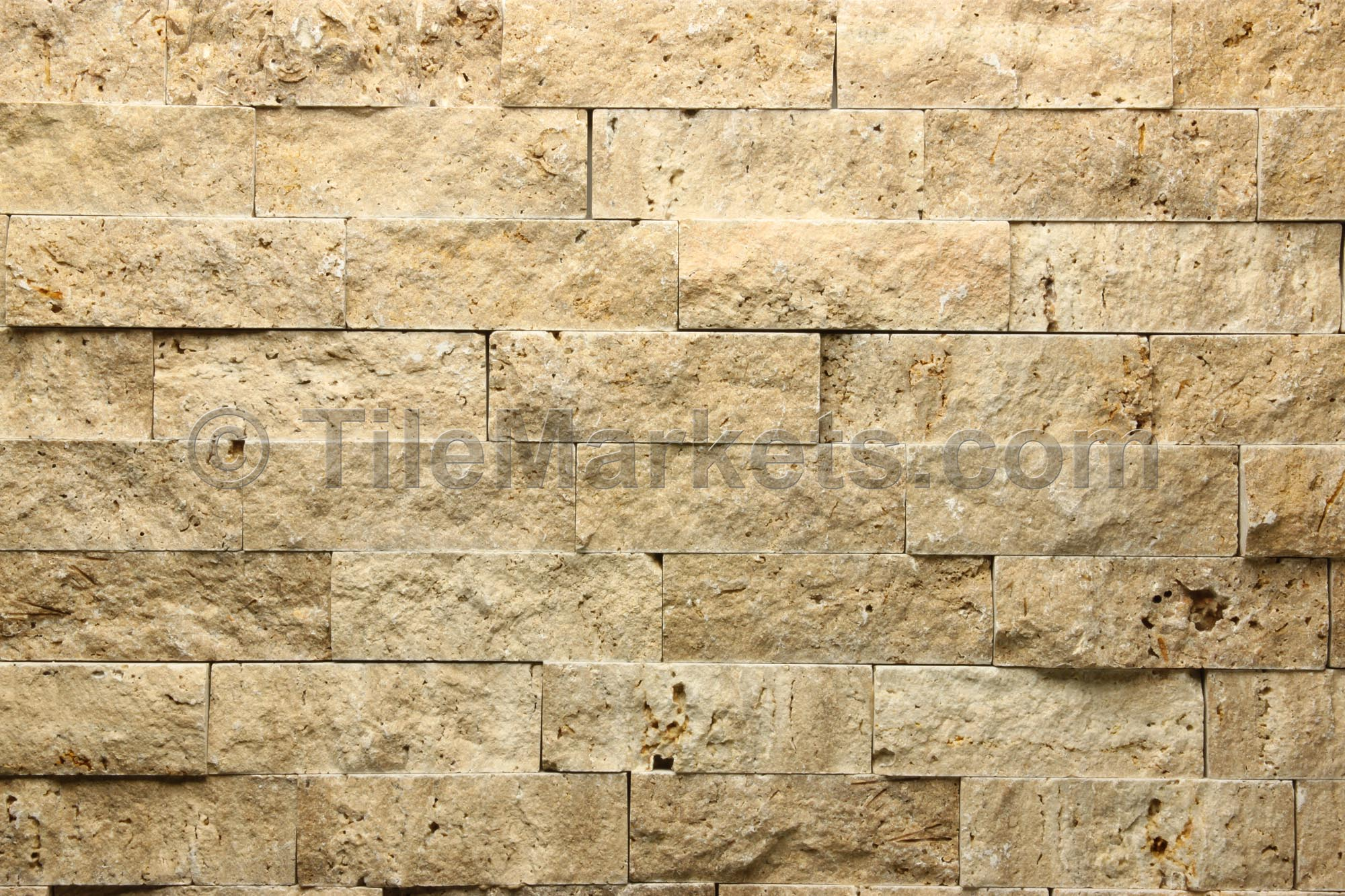 Avenzo travertine splitface noce tilemarkets for Travertine accent tile